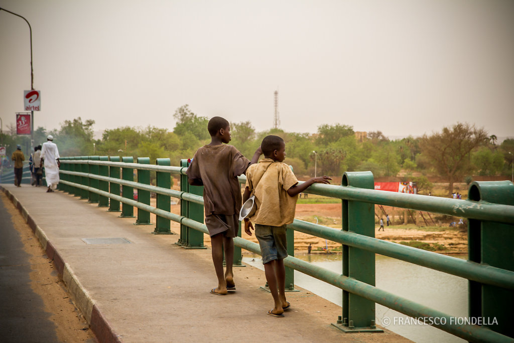 Boys on a bridge